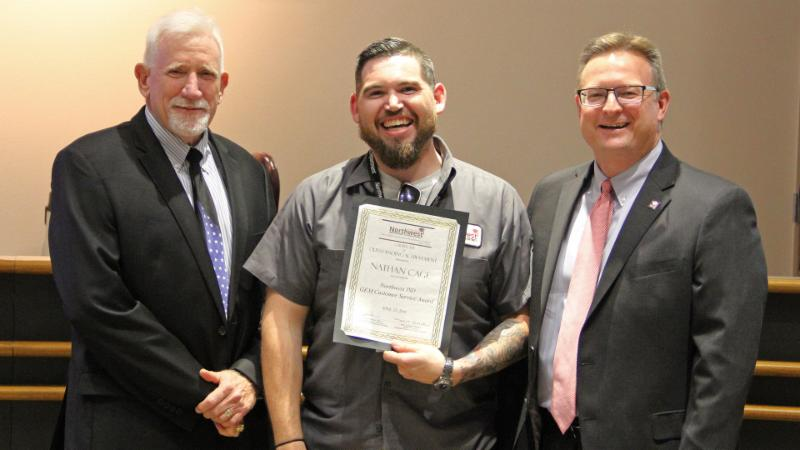 Trustees recognized Nathan Cage for being named a Going the Extra Mile award winner.