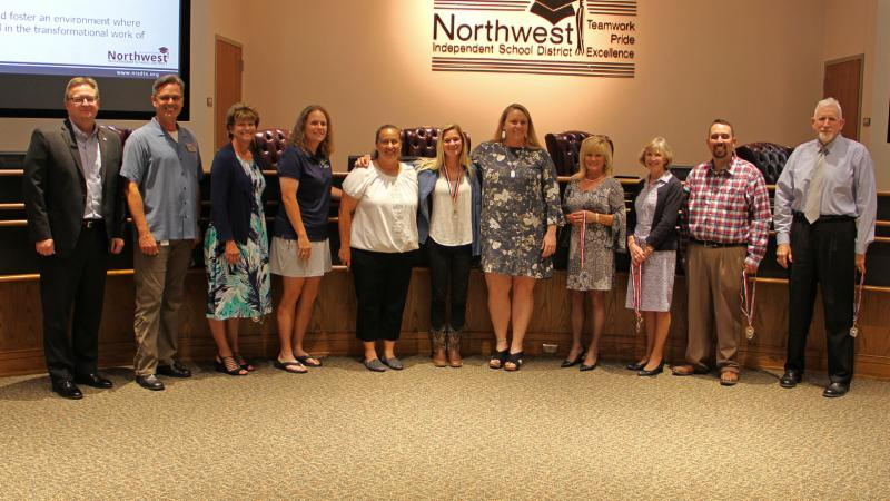 Trustees recognized the Eaton softball team_ 5A regional semifinalists.