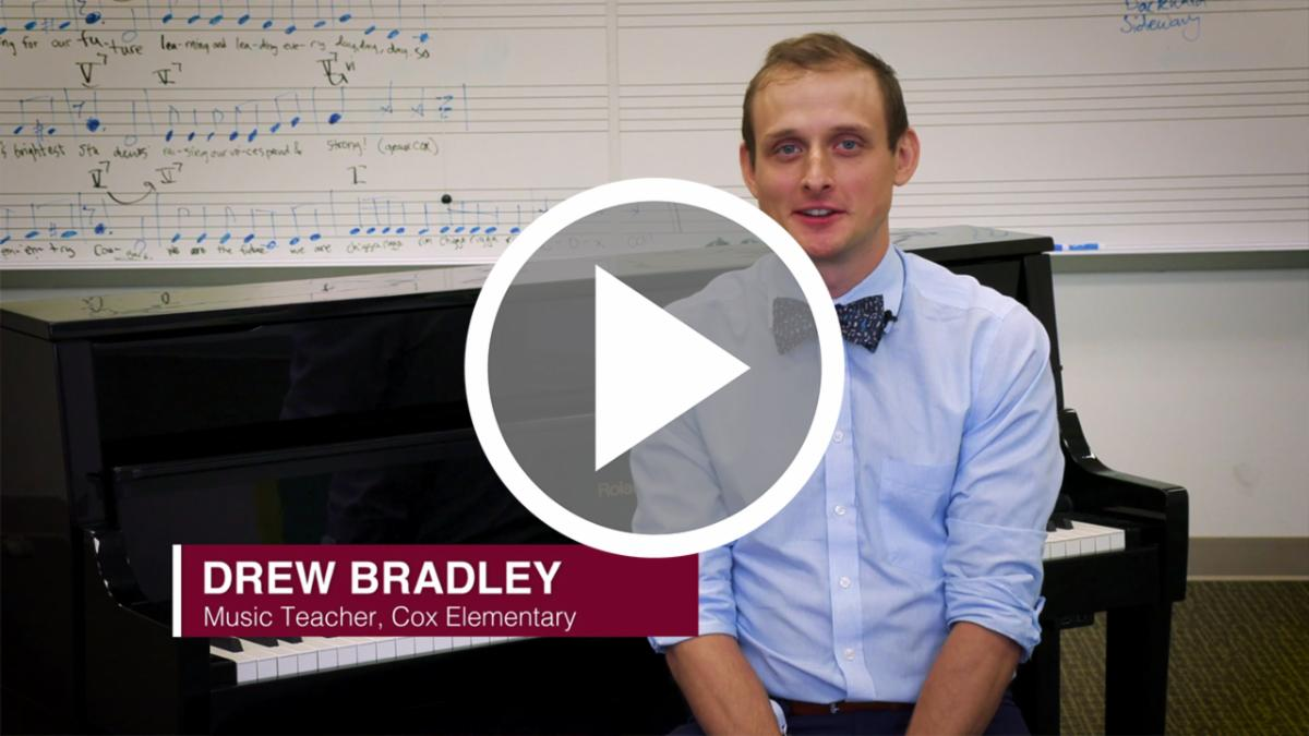 A still image from a video featuring Drew Bradley by a piano