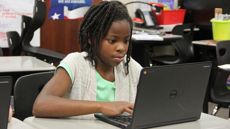 A student uses a Chromebook