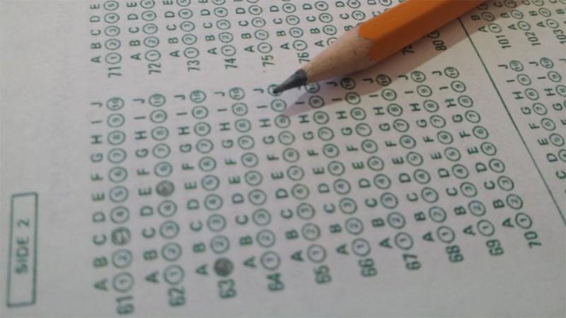 A pencil laying on an exam