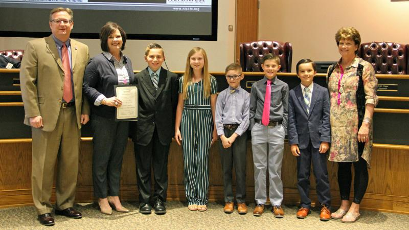 Seven Hills students pose after being recognized for their speeches