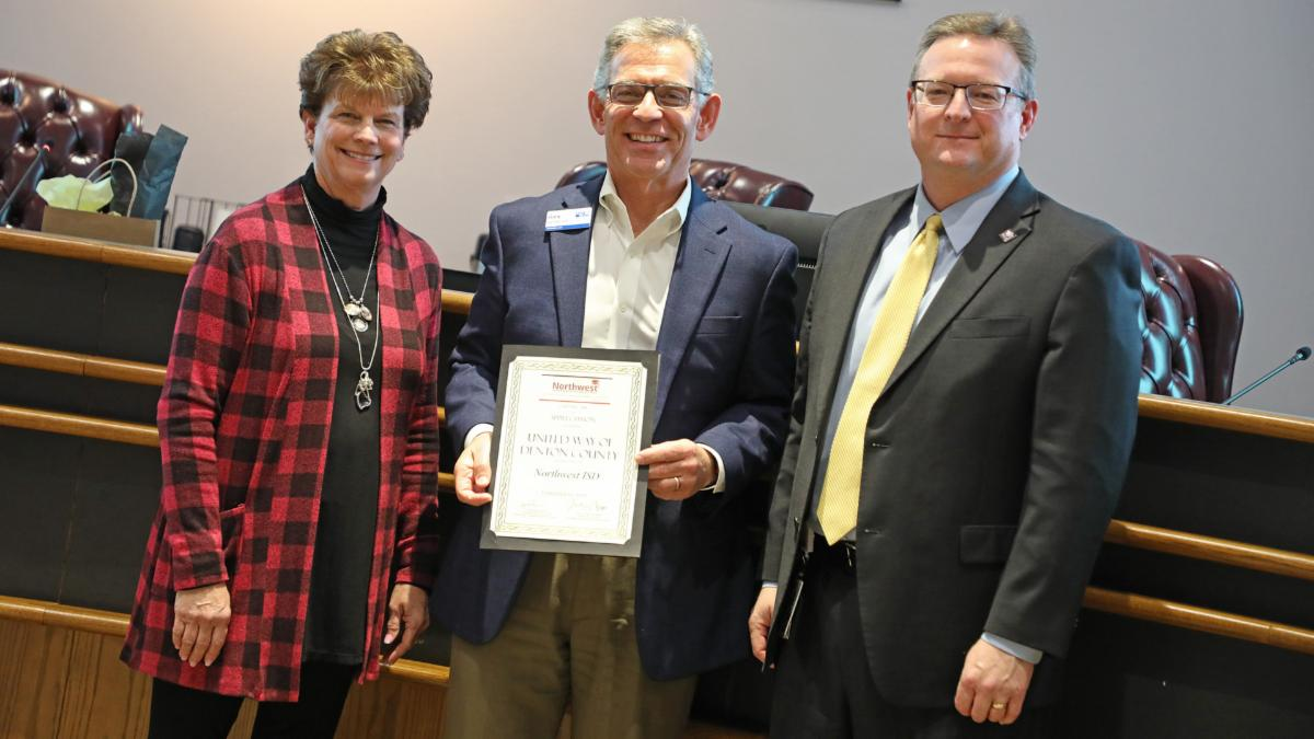 Trustees recognize Gary Henderson of United Way.