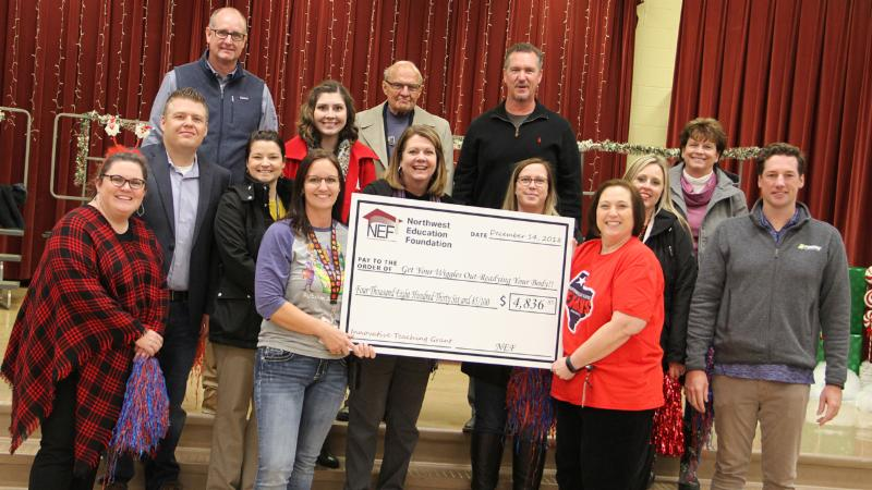Teachers from Hatfield hold their grant check