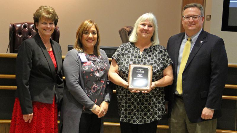 Trustees recognize Bell's Book Nest