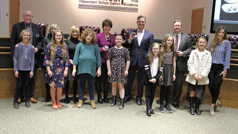 Students from Justin Elementary School's art club provided trustees with gifts for recognition of their service.