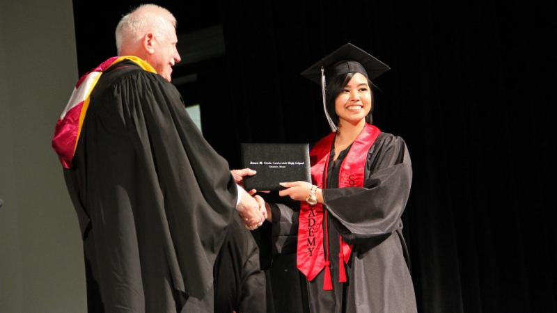 A student graduates from Steele in 2017