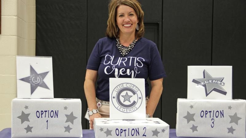 Principal Carrie Pierce poses with Curtis Elementary logo options