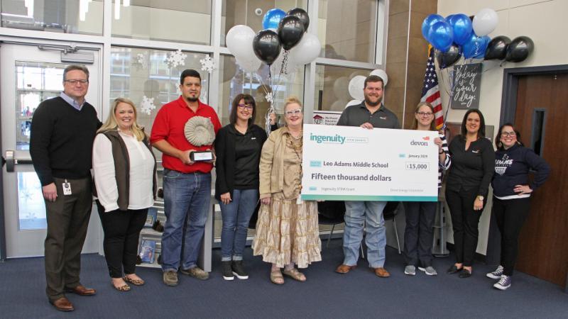 Adams Middle School accepts its $15,000 Devon Energy grant
