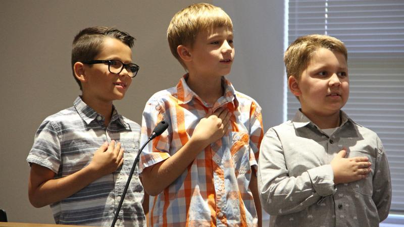 Thompson Elementary School students led the pledge.