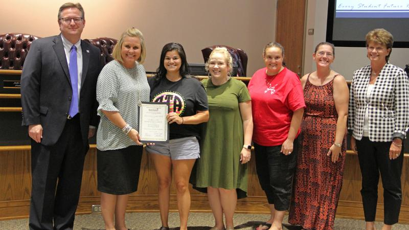 Trustees recognized Love_s PTA for winning a National PTA award.