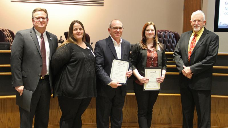 Trustees recognized members of the district_s purchasing teams for a recent department award.