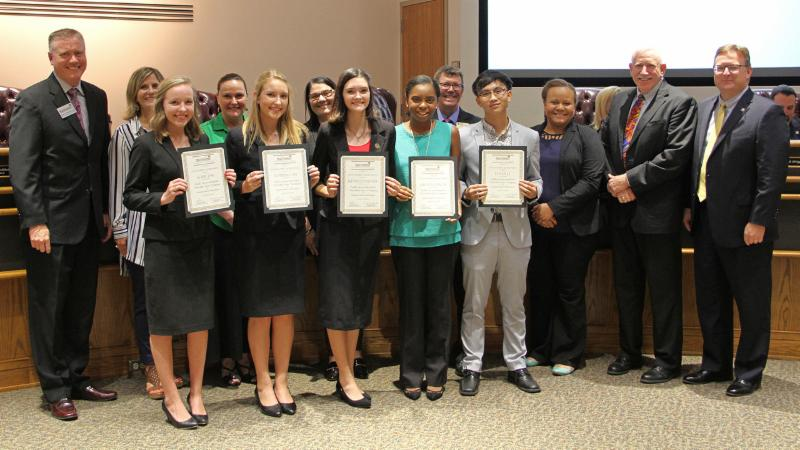 Trustees recognized Eaton student company Feel the Color for being named a Junior Achievement Company of the Year finalist.