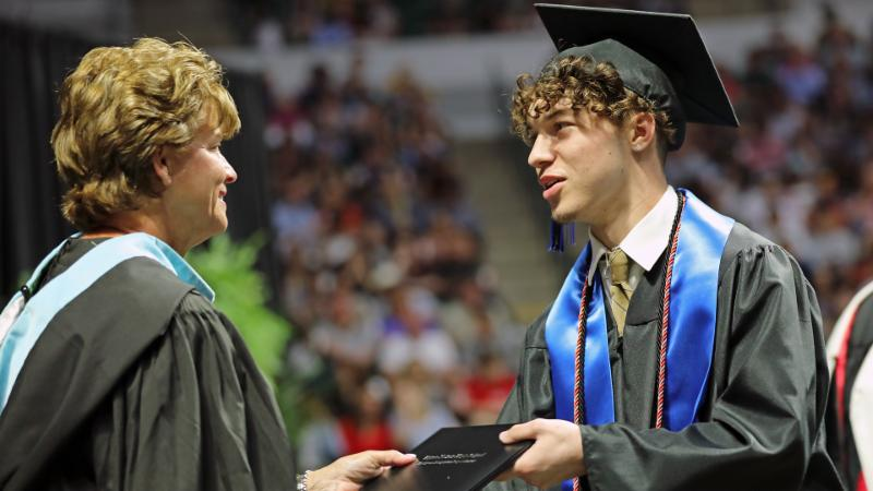 A Byron Nelson student accepts his diploma