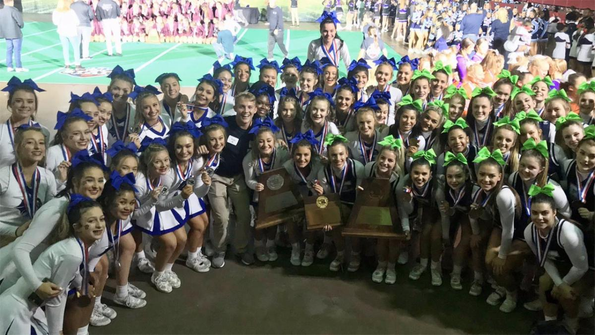 The Byron Nelson and Eaton cheerleading squads pose for a photo at the UIL state meet