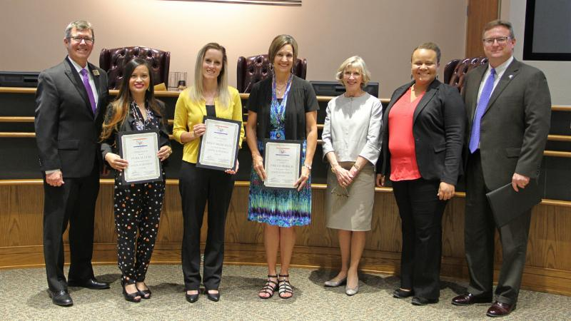 Trustees recognized educators who lead the Junior Achievement programs at their schools.