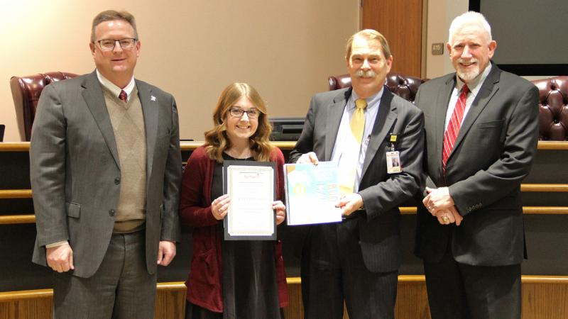 Trustees recognized Adela Baxleyoa_ winner of the district_s budget cover art contest.