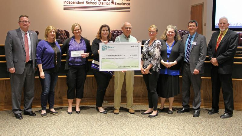CoServ donated more than _8_700 to Pike and its PTA for a meal program they provide.