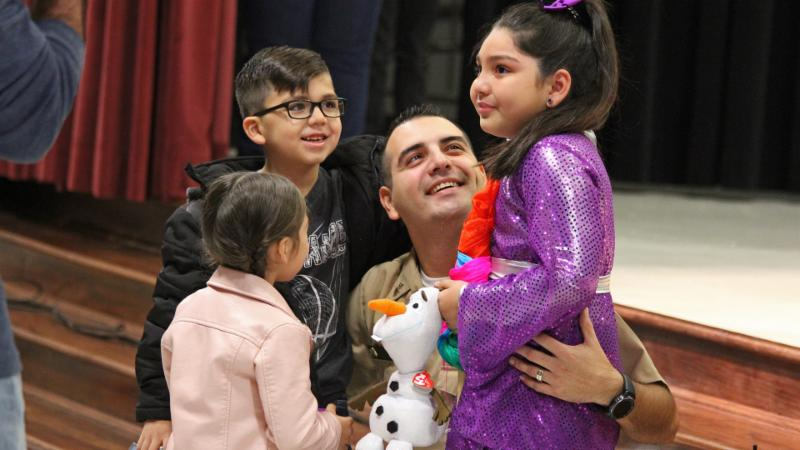 Jose Trevino reunites with his children for a leave during deployment