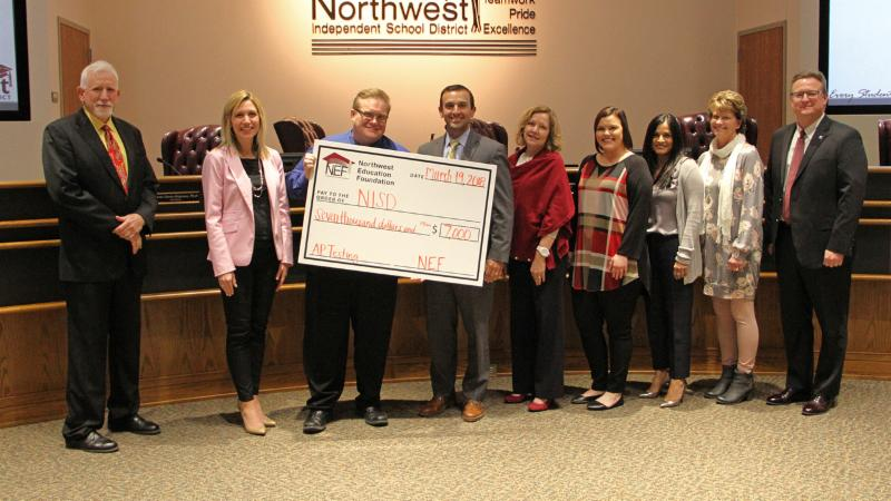 Following its recognition_ NEF donated _7_000 to the district for AP testing.