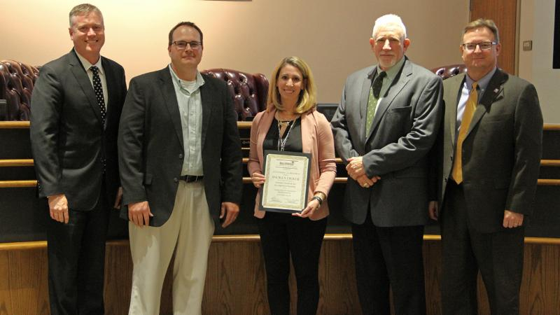 Trustees recognized Wilson_s Andrea Driver for her work setting national teaching standards.