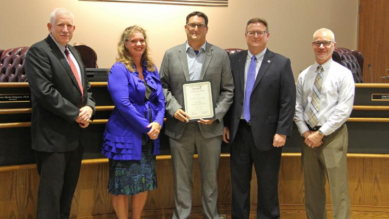 Trustees recognized Byron Nelson High School_s Todd Rogers for receiving a top professional honor from Texas PTA.