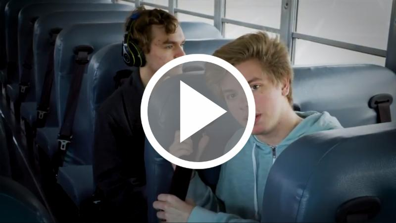 A student using a seat belt on a bus_ click to watch the video