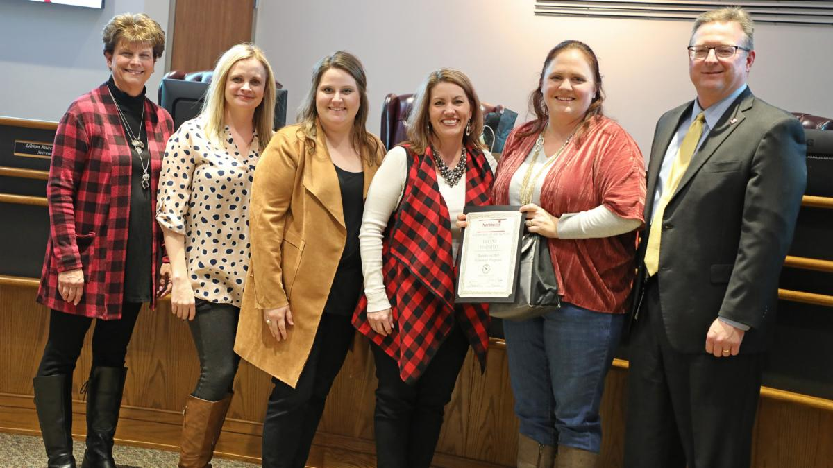 Trustees recognized the volunteer of the month Tiffany Mahaffey