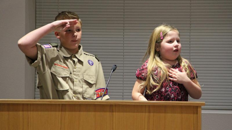 Cox Elementary School students led the Pledge of Allegiance