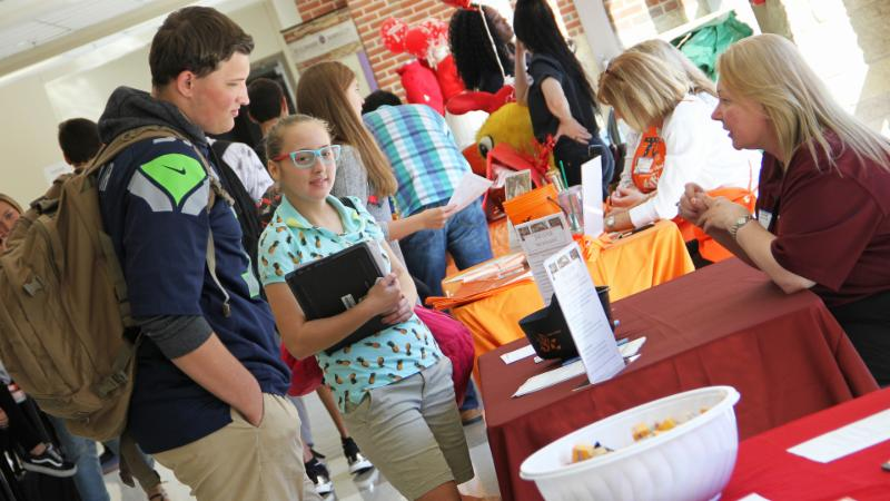 Students visit with a business at a PIE job fair