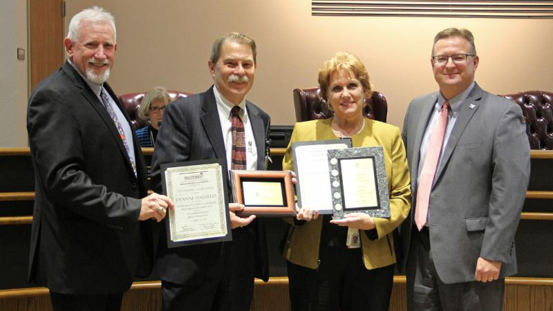 Trustees recognized the finance department for awards in financial transparency and accountability.