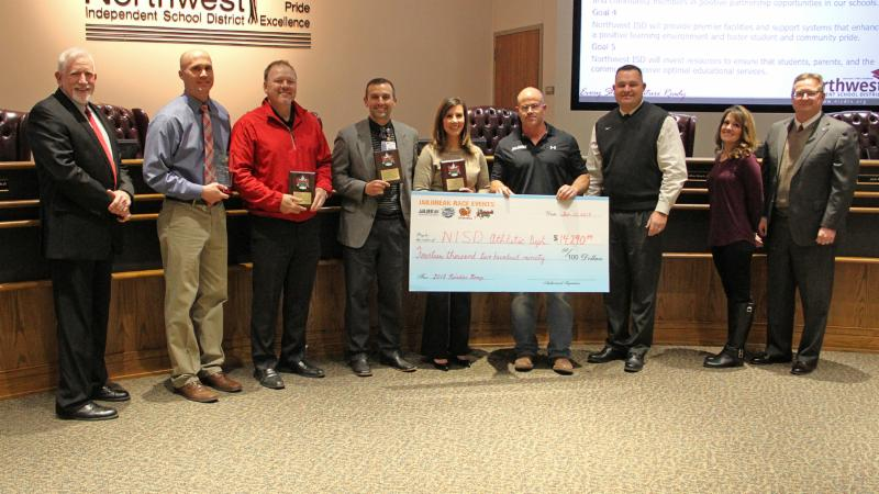 Trustees recognized sponsors of the Reindeer Romp _Fieldhouse Fitness_ Moritz Kia_ Alliance Airport_ Hillwood Properties_ Texas Health and Fit-N-Wise_ and received a check for _14_000 to provide to P.E. departments.