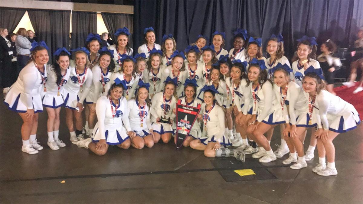 Byron Nelson cheerleaders pose for a photo at NCA High School Nationals