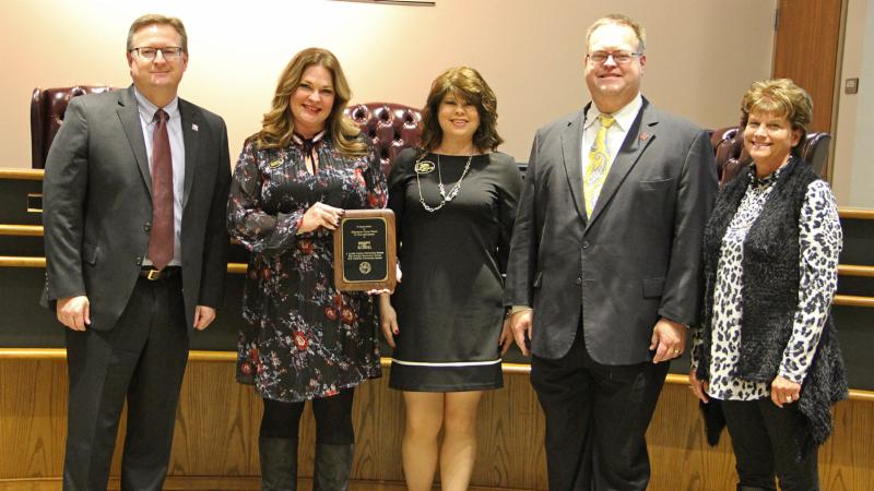 Trustees recognized Milestone Home Team for serving as a district Adopt-A-School sponsor.