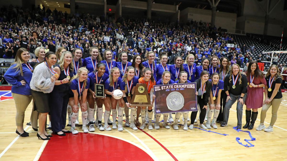 The Byron Nelson volleyball team poses with their trophy and medals after winning the 2019 state championship.