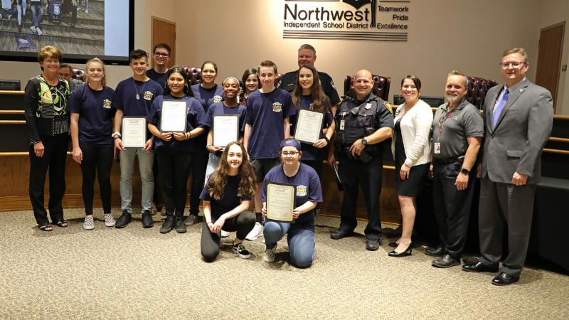 Trustees recognized Adams Middle School students who participated in the Teen Police Academy.