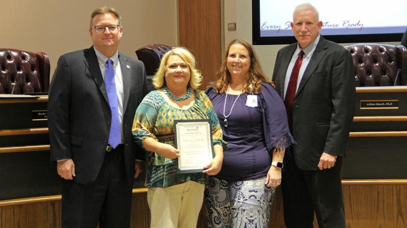 Trustees recognized Marcie Conrad for receiving an award from the Department of Texas Veterans of Foreign Wars.