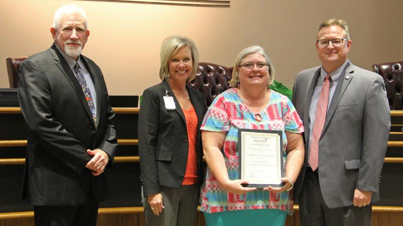 Trustees recognized Martha Yorston for winning the GEM Award for outstanding customer service.