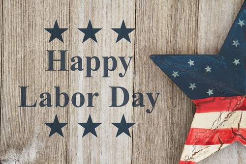 Happy Labor Day Greeting_ USA patriotic old star on a weathered wood background with text Happy Labor Day