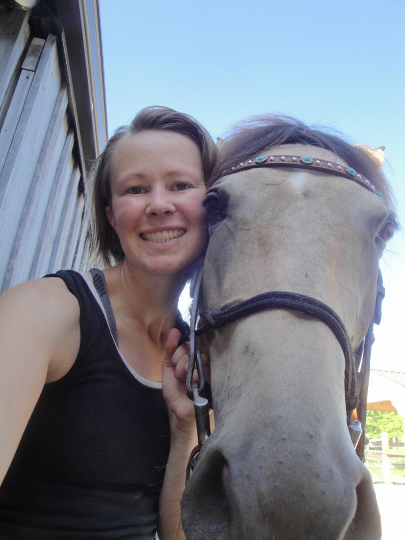Cynthia Linsenbardt_ blonde woman with white horse