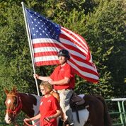 veteran with flag on horse