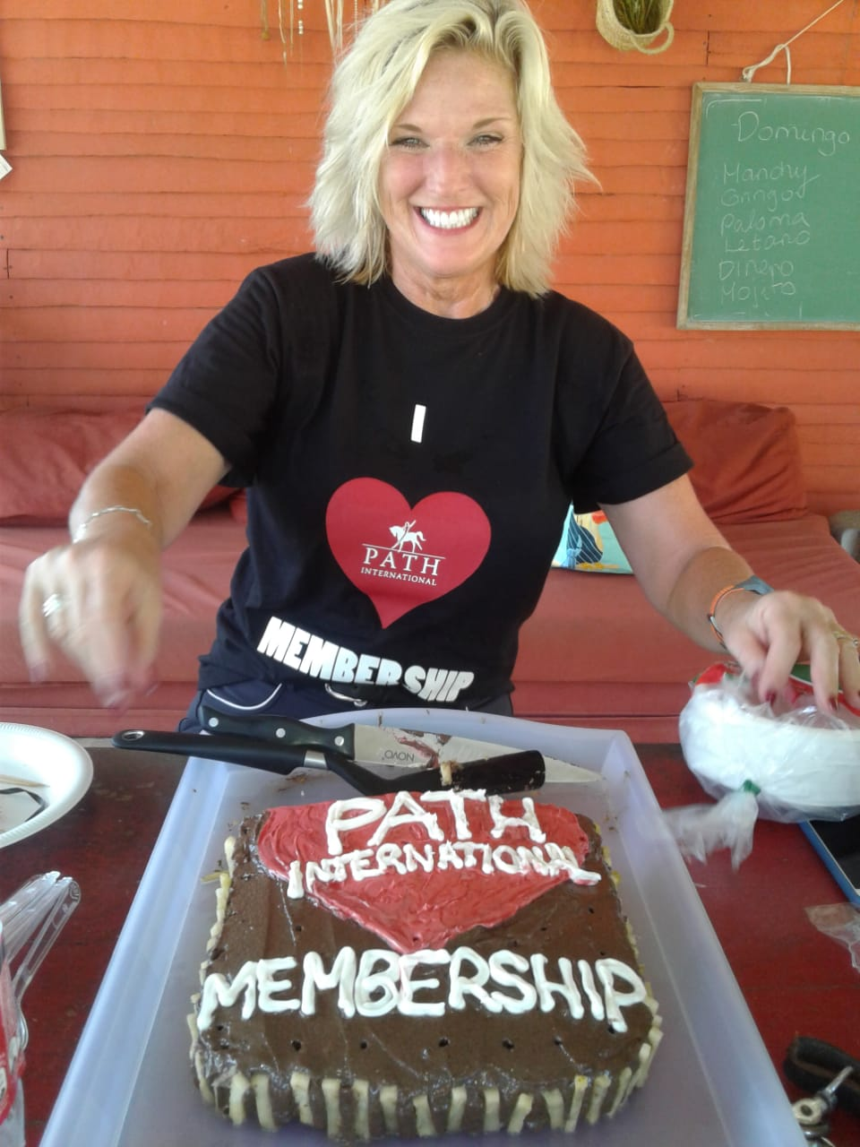 Ruth Claus with PATH Intl. Membership cake