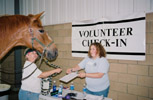 photo of volunteer and horse checking in