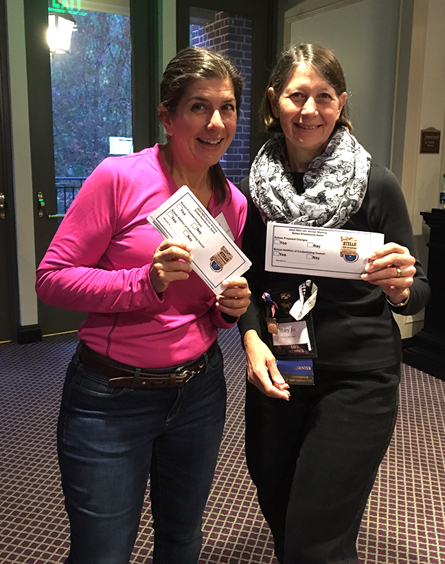 Teresa Morris and Mary Jo Beckman hand out ballots at the 2016 PATH Intl. Annual Meeting