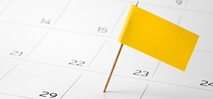 calendar with a yellow flag marking deadline