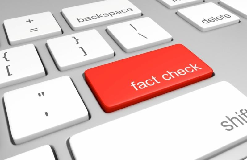 keyboard highlighting the word fact check in red