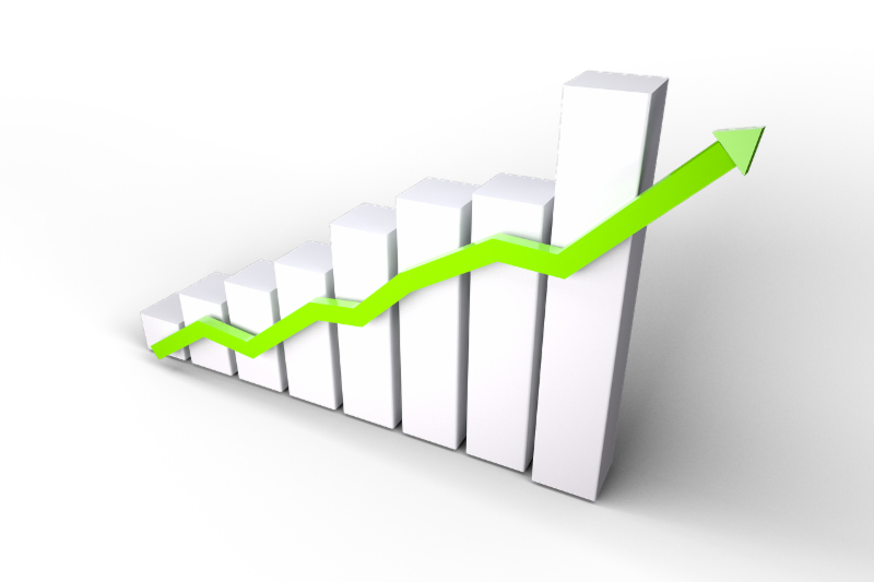 3D bar graph with a green arrow on top indicating growth.