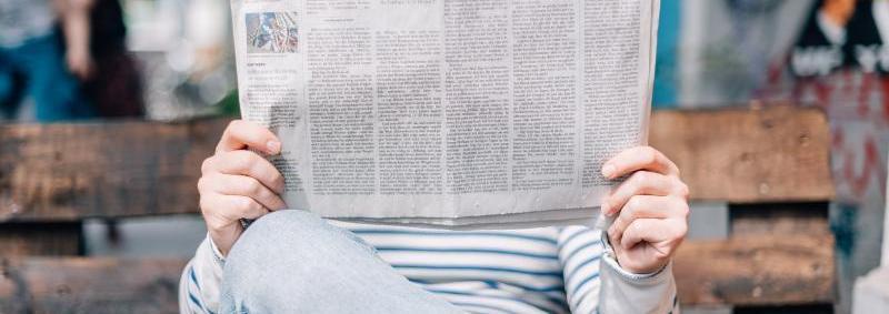 Man_s hands holding a newspaper