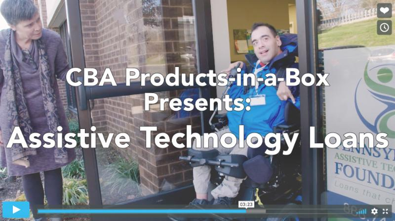 Screenshot of a Vimeo video showing a man driving a power wheelchair out a door that is held by a woman. He is smiling. Next to the door is a Pennsylvania Assistive Technology Foundation in the window. Overlaid over the photo are the words_ CBA Products-in-a-Box Presents_ Assistive Technology Loans.
