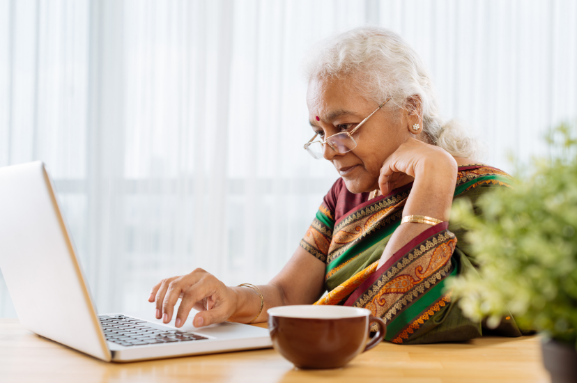 eastern indian senior woman looking at laptop.png